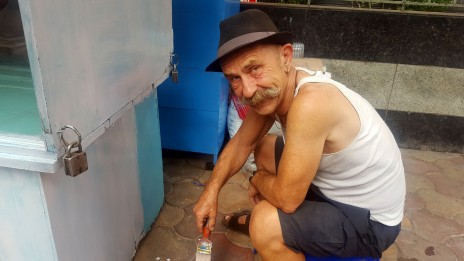 Bob Painting Manek's new Stall